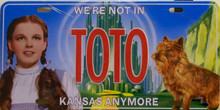 """EMBOSSED METAL WIZARD OF OZ LICENSE PLATE (DORTHY & TOTO)  WITH SLOTS FOR EASY MOUNTING MEASURES 12"""" X 6""""     """"WE'RE NOT IN KANSAS ANYMORE"""""""