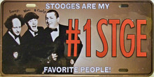 "STOOGES LICENSE PLATE  ""#1 STG""  MEASURES 12"" X 6""  WITH SLOTS FOR EASY MOUNTING"