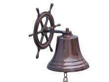 "Elegantly designed and gleaming with a lustrous shine, this fabulous Antique Copper Hanging Ship Wheel Bell 10"" is equally stunning indoors or out. In addition to being fully functional, this shipS wheel bell is a great addition to any existing nautical theme in your home. Make metal nautical wall art shine through and enjoy this wonderfully decorative style and distinct, warm ""strike through"" nautical tone with each and every resounding ring.  Note: Each ships bell's length is measured from the highest point of its hanger to the lower lip of the bell, while the width is the diameter of the flared bell opening.  Dimensions: 7"" Long  x 9"" Wide x 10"" High  NOTE: Wall mounting hardware not included. ◦Handcrafted from copper by our master artisans  ◦Fully functional marine bell with a deep rich strike through tone  ◦Solid, sturdy and heavy ◦Wonderful ships wheel decoration ◦Perfect nautical home decor  ◦Polished to a lustrous shine"