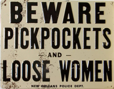Photo of BEWARE PICKPOCKETS AND LOOSE WOMEN EMBOSSED METAL SIGN