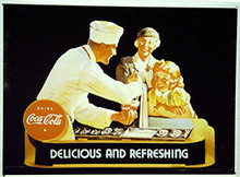 THIS OLD TIME COKE SIGN HAS BEEN OUT OF PRINT FOR SEVERAL YEARS, IT HAS GREAT COLOR AND DETAIL. WITH HOLES IN EACH CORNER FOR EASY MOUNTING, WE HAVE SEVERAL STILL IN STOCK.  THIS VINTAGE SIGN SHOWS GRANDMA AND HER GRAND DAUGHTER GETTING A COKE AT THE FOUNTAIN