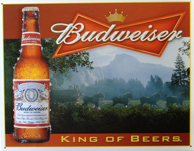 Photo of BUD KING OF BEERS SIGN WITH THE CLYDESDALES PULLING THE WAGON THROUGH THE MORNING MIST, GREAT COLOR AND DETAIL