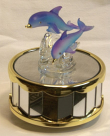 "BLUE GLASS DOLPHINS ON MIRROWED BASE CAROUSEL  PLAYS BEAUTY & THE BEAST 4"" X 4"" X 4 1/4""  HAND CRAFTED & HAND PAINTED"
