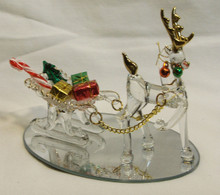 """GLASS REINDEER PULLING SLEIGH W/GIFTS ON MIRROR  22K GOLD TRIM 4 3/4"""" X 3 1/4"""" X4""""  HAND CRAFTED & HAND PAINTED"""