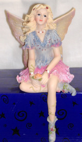"""PORCELAIN FAIRY SITTING ON SHELF IN BLUE AND PINK  3 7/8"""" X 4 3/4"""" X 7"""" HAND CRAFTED & HAND PAINTED"""
