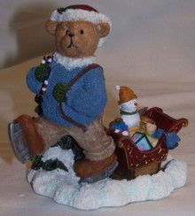 "BEAR CUB ON ICE SKATES PULLING SLEIGH WITH TOYS  MEASURES 5 1/4"" X 3 1/4"" X 4 3/4"""