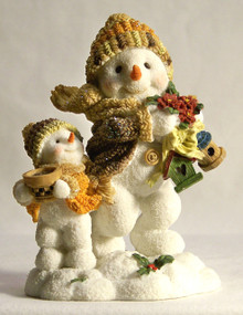 """SNOW CHILDREN ON THEIR WAY TO FEED THE BIRDS  MEASURES 3 3/8"""" X 2 1/4"""" X 4 1/2"""""""