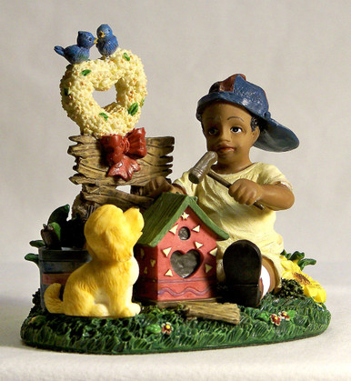 """AFRICAN AMERICAN LAD BUILDING BIRD HOUSE WITH PUPPY MEASURES 3 3/4"""" X 2 5/8"""" X 3 5/8"""""""