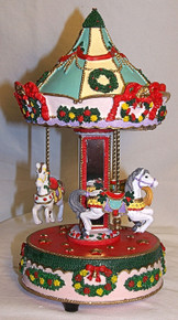 """MUSICAL HORSE CAROUSEL PLAYS WHITE CHRISTMAS  MEASURES 5 3/4"""" X 5 3/4"""" X 10 3/8"""""""