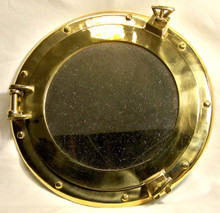 "HEAVY BRASS PORTHOLE MIRROR (MIRROR MEASURES 7 3/8"" ACTUALLY OPENS  11 3/8"" X 2 1/4"" X 11 3/8"""