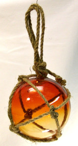 "SMALL SUNSET GLASS FLOAT MEASURES 5"" X 5"" X 10"" WITH ROPE"