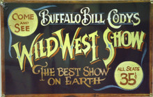 """BUFFALO BILL CODY'S WILD WEST SHOW SIGN PORCELAIN FINISH ON HEAVY STEEL PLATE THIS SIGN IS OUT OF PRINT, WE HAVE TWO LEFT. SIGN HAS HOLES IN EACH CORNER FOR EASY MOUNTING AND MEASURES 13 1/2"""" X 8 3/4"""""""