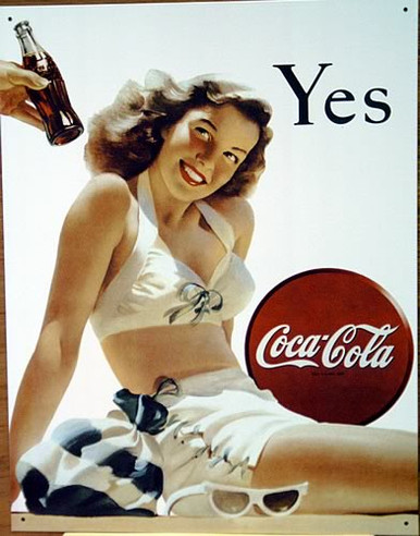 Photo of COKE YES SIGN HAS A GIRL IN A BIKINI GETTING READY TO SAY YES TO A COKE BEING OFFERED (BY A YOUNG MAN?) GREAT COLOR AND GRAPHICS IN THIS SIGN