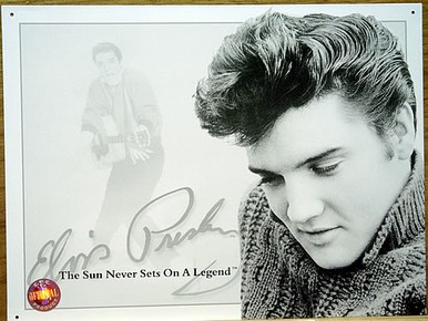 Photo of ELVIS SUN NEVER SETS ON A LEGEND SIGN SHOWS ELVIS IN THE FOREGROUND IN A SWEATER AND PLAYING GUITAR IN THE BACKGROUND, THIS IS A VERY POPULAR SIGN