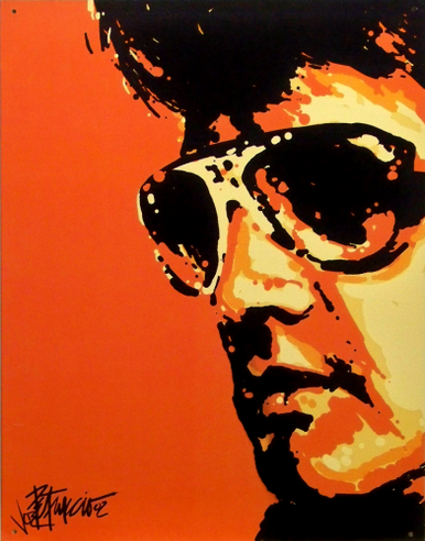Photo of ELVIS TIGERMAN SIGN, SHOWS ELVIS WEARING HIS SHADES WITH AN ORANGE CAST ON HIS FEATURES.