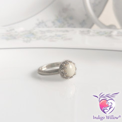 This gorgeous design features a beautiful heart design that forms a crown completely encircling and protecting your precious breast milk stone made using your own milk and delicate beading at the base of the crown.