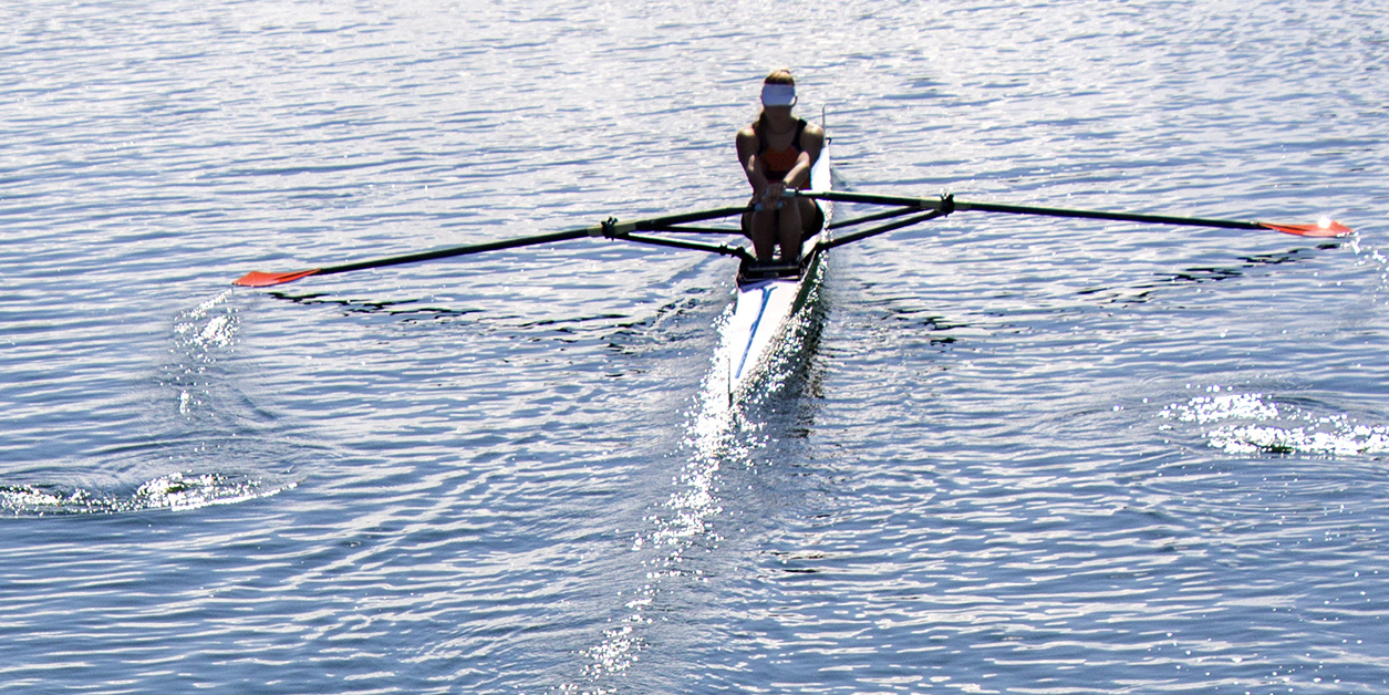 Sculling Gear Everyday Collection: Image of a female sculler rowing.