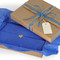 """Inside the box, each item is carefully wrapped in royal blue tissue paper and """"sealed with a kiss"""" in the form of a small, burnished-gold toned heart sticker."""
