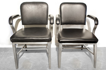 SOLD - Pair of Emeco Aluminum Solid Back Arm Chairs, 1950s