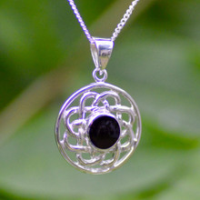 Medium round silver Celtic pendant with Whitby Jet