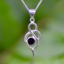 Contemporary sterling silver pendant with round Whitby Jet stone on curb chain