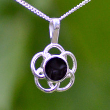 Contemporary sterling silver flower pendant with round Whitby Jet stone