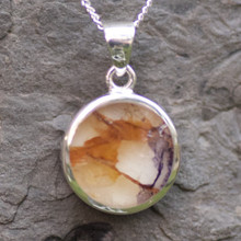 Round Derbyshire blue john pendant on sterling silver chain