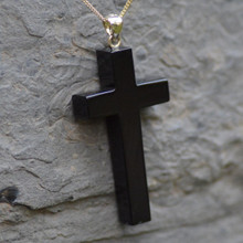 large whitby jet carved cross pendant on 9ct gold chain