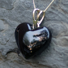 Hand carved Whitby Jet heart pendant on 9ct gold curb chain