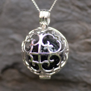 whitby jet and sterling silver caged fairy ball pendant