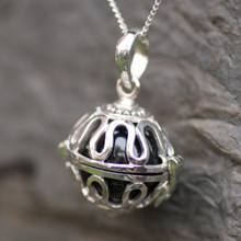 whitby jet caged fairy ball pendant on sterling silver chain