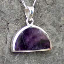 semi circular derbyshire blue john and sterling silver pendant