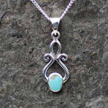 Handmade Kingman turquoise and sterling silver scroll pendant with oval stone