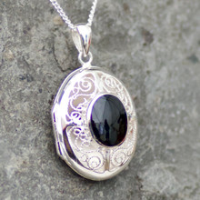 Large oval filigree Whitby Jet and sterling silver locket pendant