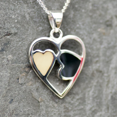 handmade whitby jet and baltic butterscotch amber and sterling silver hearts pendant