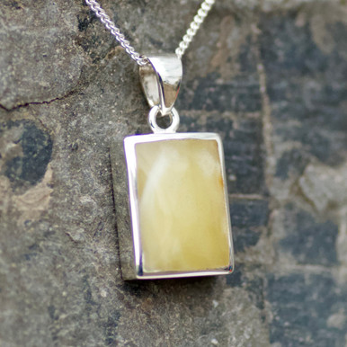 baltic amber ingot pendant on silver chain