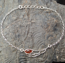 Cognac Baltic amber and 925 sterling silver angel wing charm bracelet