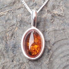 Cognac amber and 925 sterling silver oval pendant