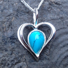 Sterling silver open heart pendant with turquoise reverse teardrop shaped stone