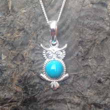 Small Turquoise and sterling silver owl pendant with sparkly cubic zirconia eyes