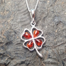 Cognac amber and sterling silver four leaf clover pendant