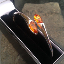 Sterling silver and cognac amber marquise stone bangle