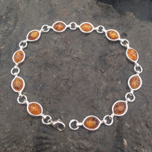 Sterling silver multistone bracelet with oval marquee cognac amber stones