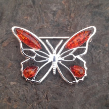 Sterling silver butterfly brooch with four cognac amber stones