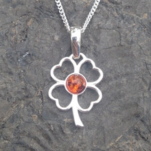 sterling silver four leaf clover pendant with cognac amber cabochon