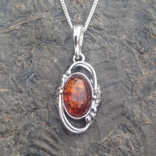 Sterling silver fancy oval cognac amber pendant