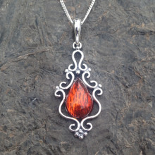 Fancy sterling silver pendant with cognac amber teardrop stone