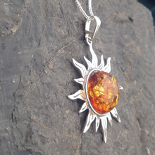 Large sterling silver sun pendant with cognac amber cabochon