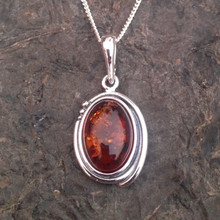 Sterling silver oval pendant with cognac amber