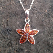 Sterling silver pendant with five cognac amber stones